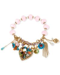 Betsey Johnson | Metallic Gold-tone Multicolor Woven Heart Stretch Bracelet | Lyst