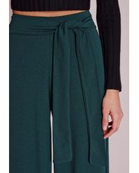 Missguided - Blue Tie Belt Crepe Wide Leg Trousers Teal - Lyst