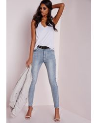 Missguided | Sinner High Waisted Ripped Skinny Jeans Washed Blue | Lyst