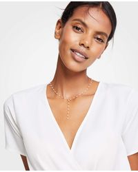 Ann Taylor - Metallic Delicate Pearlized Lariat Necklace - Lyst