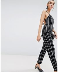 ee49a61bc39d PrettyLittleThing Stripe Jumpsuit in Black - Lyst