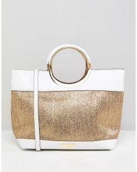 d663a558fec2 Carvela Kurt Geiger Circle Handle Raffia Tote Bag in Metallic - Lyst