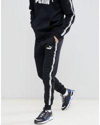 53443f2832cb7 Pantalon de jogging avec bande PUMA pour homme en coloris Noir - Lyst