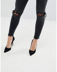 ASOS - Ridley High Waist Skinny Jeans With Tie Knees In Black - Lyst