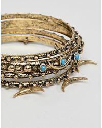 fdb0fdc931e8 Pack de brazaletes a capas en tono dorado pulido de ASOS de hombre ...