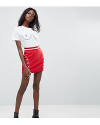4f98cf433237 Lyst - Missguided Lace Up Mini Skirt in Red