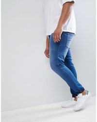 ASOS DESIGN - Plus Super Spray On Jeans In Mid Blue for Men - Lyst