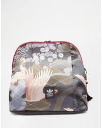 2a7cd8c4b9 Lyst - adidas Originals Rita Ora Bird Print Backpack in Black