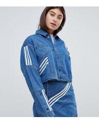 8624a3c641 adidas Originals. Women s Blue X Danielle Cathari Diagonal Side Stripe Denim  Jacket