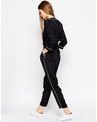 ASOS - Black Wrap Jumpsuit With Peg Leg In Minimal Spot And Contrast Piping - Lyst