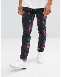 ASOS - Blue Skinny Pants In Oversized Rose Print for Men - Lyst