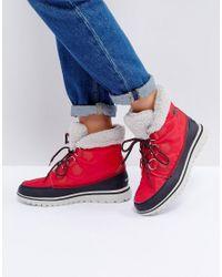 Sorel | Cozy Carnival Red Waterproof Flat Boots | Lyst