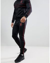 Gym King Skinny Red Piping Joggers In Black for men