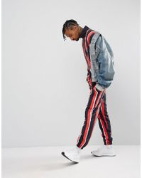 Granted Joggers In Black And Red Stripe for men