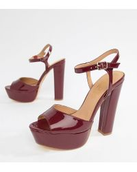 ccff2a6751186 Truffle Collection Platform Heeled Sandals in Red - Lyst