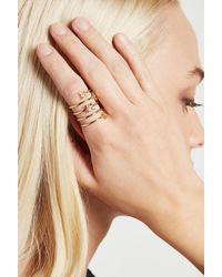 BCBGeneration - Metallic Floral Star Coil Ring - Lyst