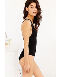 Out From Under - Black Zip Racerback Bodysuit - Lyst