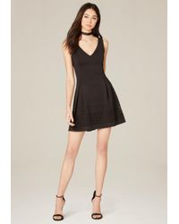 Bebe | Black Laser Cut Fit & Flare Dress | Lyst