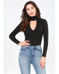 Bebe | Black Mock Neck Sweater Bodysuit | Lyst