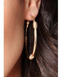 Bebe | Metallic Wrap Hoop Earrings | Lyst