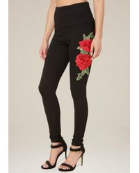 Bebe | Black Rose Hip Tux Leggings | Lyst