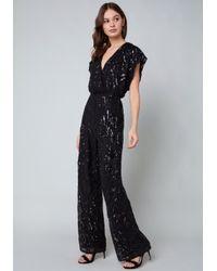 Bebe - Black Allover Sequin Jumpsuit - Lyst