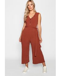 2510e3d57d63 Lyst - Boohoo Plus Ribbed Button Culotte Jumpsuit in Red