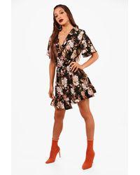 8c69cb5baec2 Boohoo Ruffle Wrap Floral Print Tea Dress in Black - Lyst