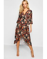64419911a0 Boohoo Floral Tie Waist Wrap Front Maxi Dress in Black - Lyst
