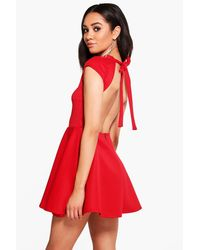Boohoo - Red Petite Hailey Scuba Backless Skater Dress - Lyst