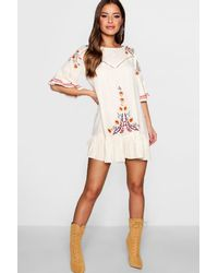 Boohoo - Natural Petite Embroidered Flare Sleeve Smock Dress - Lyst