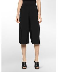 Calvin Klein | Black White Label Pleated Front Culotte Pants | Lyst