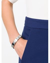 Tory Burch - Metallic Logo Bangle Bracelet - Lyst