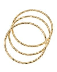 Lydell NYC | Metallic Textured Golden Stacking Bracelets | Lyst