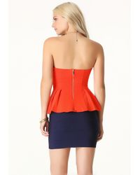 Bebe | Orange Sweetheart Peplum Top | Lyst