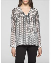 Calvin Klein | Black Semi-sheer Striped V-neck Top | Lyst