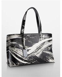Calvin Klein   Black Platinum Platinum Edged Brushstroke Leather Tote Bag   Lyst