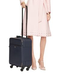 kate spade new york | Blue Cameron Street International Carry-on | Lyst