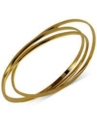Guess | Metallic Gold-tone Interlocking Bangle Bracelets | Lyst