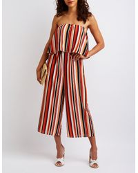 8303b2e00fb Lyst - Charlotte Russe Striped Strapless Jumpsuit in Red