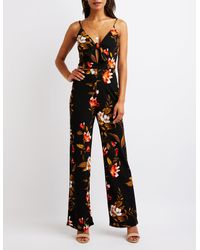 c35f679bfaf0 Lyst - Charlotte Russe Floral Cut Out Jumpsuit in Black
