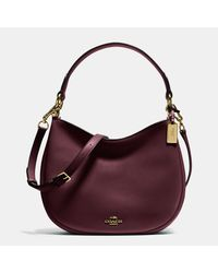 COACH - Purple Nomad Crossbody In Glovetanned Leather - Lyst