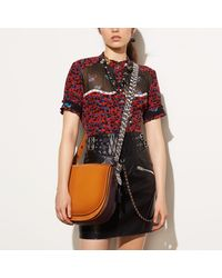 COACH - Orange Saddle Bag With Colorblock Snake Detail - Lyst