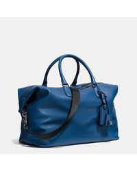 COACH - Black Explorer Bag In Pebble Leather - Lyst