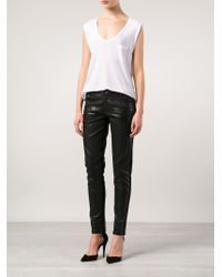 Balmain - Black Coated Skinny Mid-Rise Stretch-Denim Jeans - Lyst