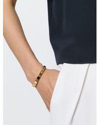 Tory Burch | Metallic Cut Out Logo Bangle | Lyst