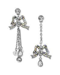 Betsey Johnson - Metallic Silvertone Crystal Bow Mismatch Earrings - Lyst