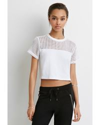 aacc8ec4199fd9 Lyst - Forever 21 Mesh-paneled Crop Top in White