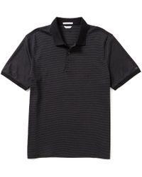 Calvin Klein | Black Liquid Cotton Short-sleeve Solid Polo Shirt for Men | Lyst