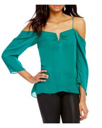 Nicole Miller Artelier   Green Schuler Cold-shoulder Long Sleeve Split-square Neck Silk Blouse   Lyst